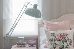 Pink pillows on bed in bedroom with green lamp Royalty Free Stock Photography