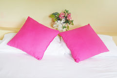 Pink pillows on white bed Royalty Free Stock Photos