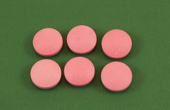 Pink pills Stock Image
