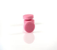 Pink pills Stock Images