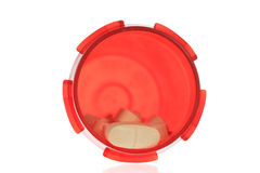 Pink Pills in Container. A photo of some pink pills in an orange container set against a white background Stock Photos