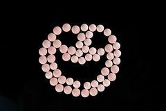 Pink pills happy face Stock Photo