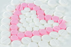 Pink pills in heart shape Stock Photography