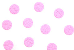 Pink pills isolated on white Royalty Free Stock Photography