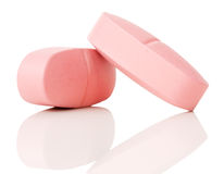 Pink pills isolated on a white background Royalty Free Stock Photos