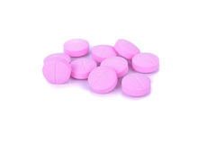 Pink pills over white macro shot Stock Photography