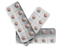 Pink pills packed in blisters isolated on white background Stock Photography