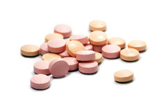 Pink pills on a small heap isolated with shadows on a white back Royalty Free Stock Images