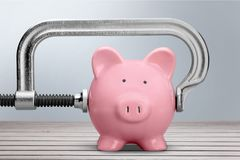 Pink Pink piggy bank and clamp stock images