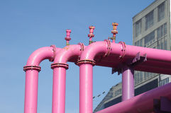 Pink pipelines over blue sky Stock Photos