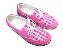 Pink plaid canvas shoes isolated on white background Royalty Free Stock Image