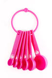 Pink plastic baking utensils Royalty Free Stock Photography