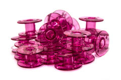 Pink plastic bobbin for sewing machine Royalty Free Stock Photo
