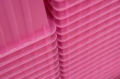 Pink plastic boxes pile. Closeup of pink plastic boxes pile stock photography