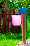 Pink plastic bucket and  rural well Stock Image