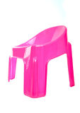 Pink plastic chair Royalty Free Stock Image