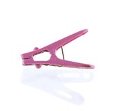 Pink plastic cloth peg and reflection Royalty Free Stock Photo