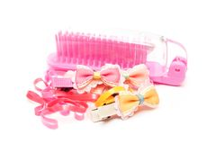 Pink plastic comb , hair band and bow Stock Image