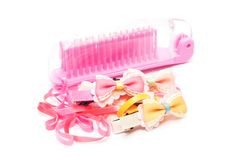 Pink plastic comb , hair band and bow Royalty Free Stock Photos