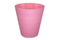 Pink plastic empty wastebasket Royalty Free Stock Images