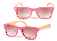 Pink plastic glasses. Closeup on white background royalty free stock photo