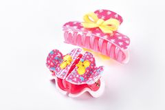 Pink plastic hair clips with bow. Royalty Free Stock Photos
