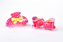 Pink plastic hair clips. Royalty Free Stock Photography