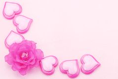 Pink plastic hearts with flower Stock Photo