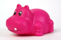 Pink plastic hippopotamus. Toy on white background Royalty Free Stock Images