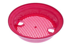 Pink plastic sand sieve. Isolated on white background stock images