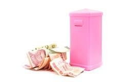 Pink plastic saving box and Thai banknotes Stock Photos