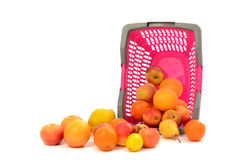 Pink plastic shopping basket full of fruits. Royalty Free Stock Photo