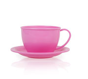 Pink plastic toy cup and saucer Royalty Free Stock Image