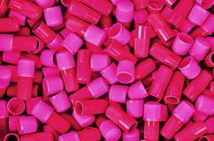 Pink plastic tubes Royalty Free Stock Image