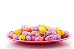 Pink plate filled with easter eggs Royalty Free Stock Photography