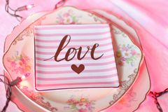 Pink plate with text love
