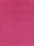 Pink plisse fabric background texture. Royalty Free Stock Photography