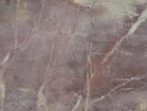 Pink polished Quartzite quartz sandstone with white veins ston royalty free stock photography