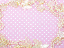Pink polka dot background and butterflied decoration. With space copy Royalty Free Stock Photo