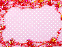 pink polka dot background and heart decoration Stock Photo