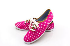 Pink polka dot canvas shoe . Stock Image