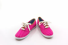 Pink polka dot canvas shoe. Royalty Free Stock Image