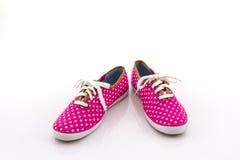 Pink polka dot canvas shoe. Royalty Free Stock Image