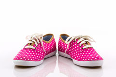 Pink polka dot canvas shoe. Stock Photos