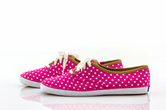 Pink polka dot canvas shoe. Royalty Free Stock Photos