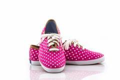 Pink polka dot canvas shoe. Stock Photos