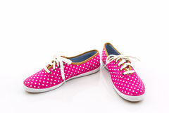 Pink polka dot canvas shoe. Royalty Free Stock Photos