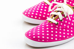 Pink polka dot canvas shoe. Stock Photography