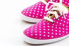 Pink polka dot canvas shoe. Stock Photography
