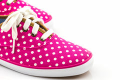 Pink polka dot canvas shoe. Royalty Free Stock Photo